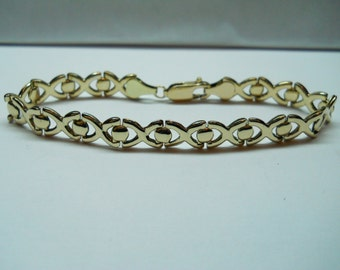 1- Gold Filled X And O Bracelet 7 Inches Long