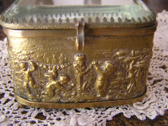 Antique Trinket Box - Cherubs in the garden around the edge and a beveled glass lid