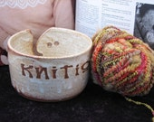"Yarn bowl with the word ""Knitiot""  in ivory"