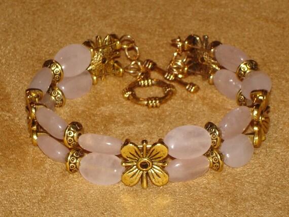 Rose quartz bracelet w/golden  flowers