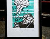 Linocut art print diver with jellyfish.