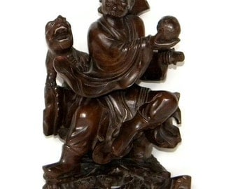 Antique chinese wood wooden carving carved figure statue of man or scholar with foo dog with glass eyes