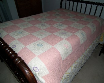 Vintage handmade embroidered pink quilt with morning glories