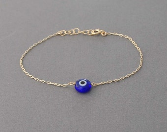 Blue Evil Eye Bracelet available in gold, rose gold, and silver