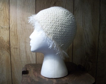 Cream crochet hat with fringe