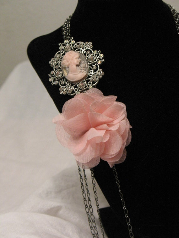 Variations - changeable flowers along with a blushing pink cameo and multi lengths of chain