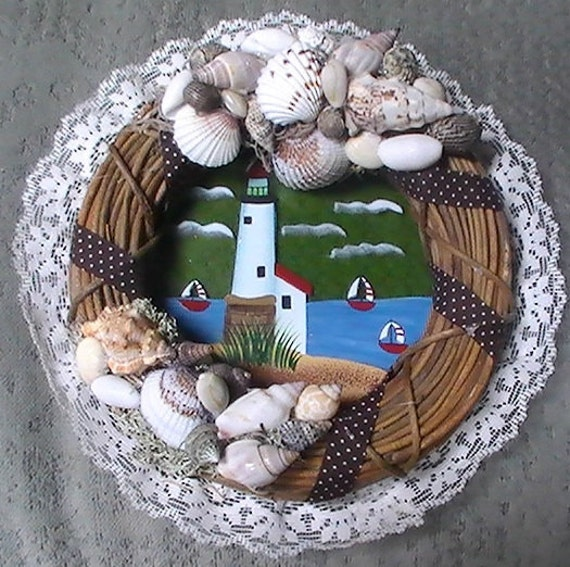 Nautical wreath with litehouse and shell decor