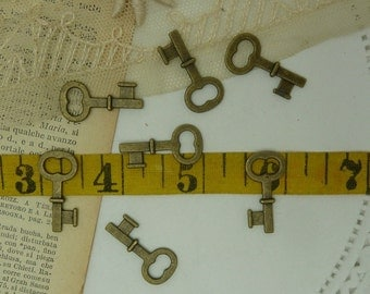 10 aged brass short  skeleton style key charms