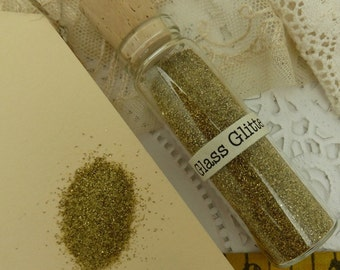 1 -1/2 oz german glass  glitter -gold  in glass corked vial-  extra fine