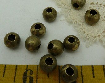 20 - large  antique  brass/ bronze  round beads 9.5 MM with 3 mm hole