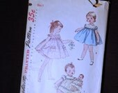 1950's Vintage Pattern Simplicity 1402 Toddlers One Piece Dress and Dolls Dress