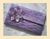 wedding clutch bag in quilted silk with flower corsage, available in violet, sugar pink, pistachio or almond with optional personalisation