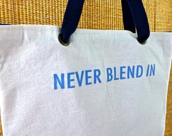 "Tote Bag: ""Never Blend In"""