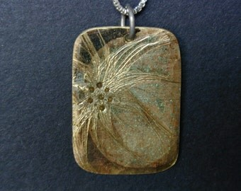 Pendant made with scrap metel, hand etched!