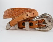 Brown Tooled Leather Belt With a Silver Buckle 28in