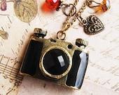 Treasured photos - a locket camera necklace