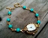 Ofelia bracelet watch / stainless steel gold & turquoise