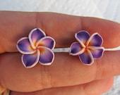 Hawaiian Purple Plumeria Frangipani Polymer Clay Post Earrings with an Orange Center.