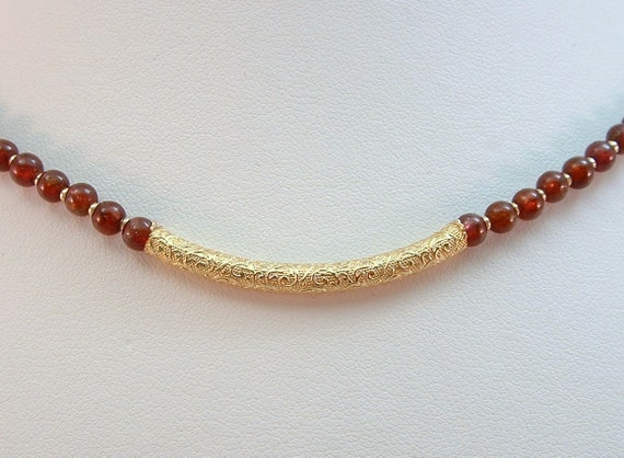 Beaded Choker Necklace of Garnet with Goldfilled Center Station.  One of a Kind