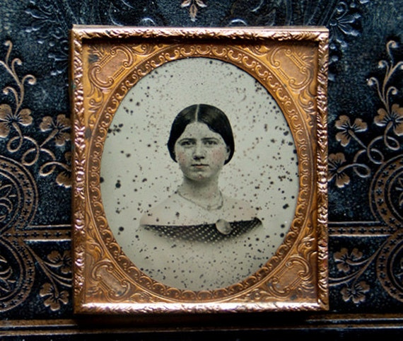 Antique Victorian Ambrotype/Young Woman/Hand Tinted/Gothic/Haunting Figure/Enigmatic Time Worn/Gold Gilt Embossed Frame/1850s.