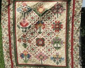 A Quilters Garden Handmade Queen Quilt with original Thimbleberries fabrics.  Price Reduced
