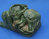 H. P. Lovecraft's Cthulhu Chac-Mool sculpture.