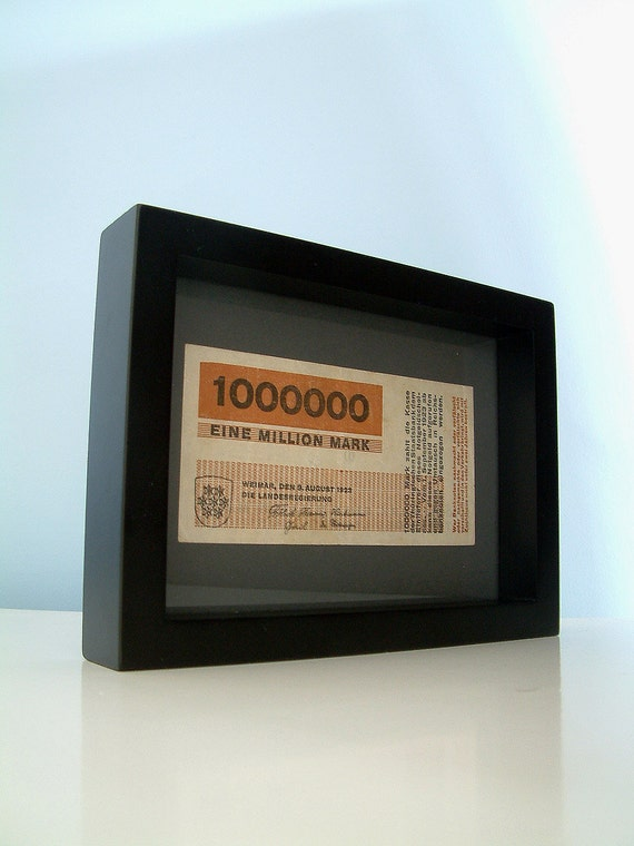 An original Weimar Republic hyperinflation banknote designed inside the Bauhaus by Herbert Bayer, 1923