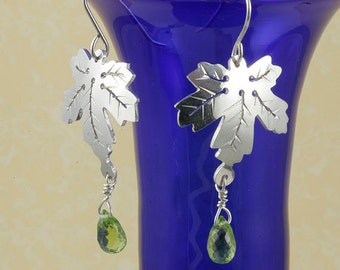 On SALE 20 TO 50% off. Maple leaf sterling silver earrings with peridot