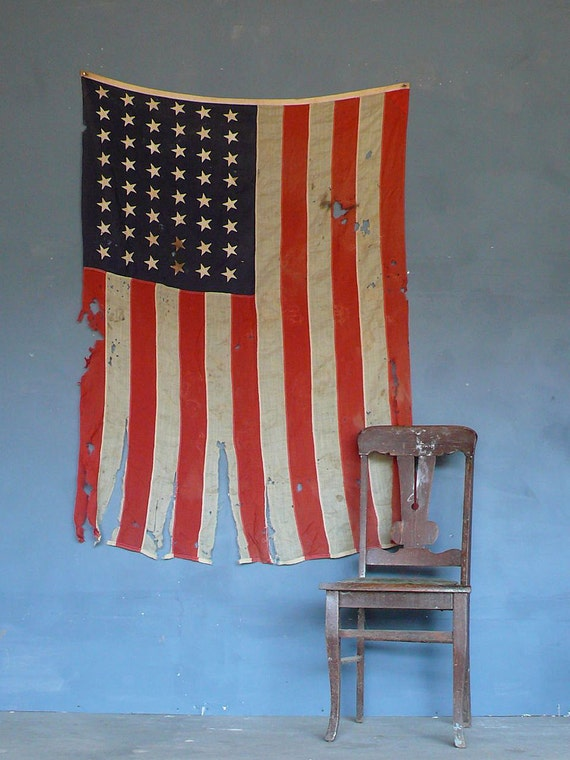 Vintage tattered and torn 48 star American flag