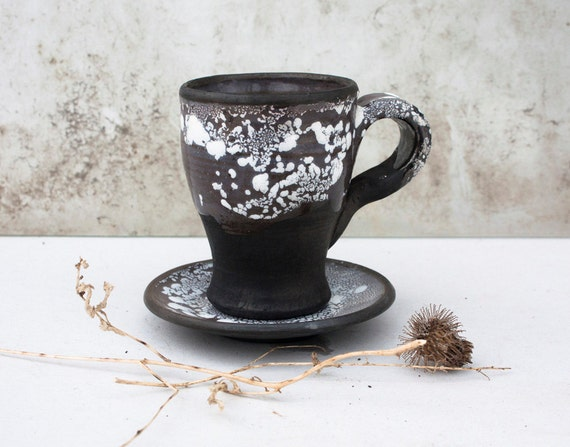 black and white coffee cup and saucer