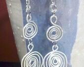 long silver swirl earrings