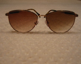 vintage Carolina Herrera sunglasses . . with matching case . . . 1980's
