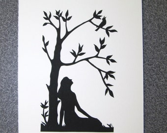 Handcut silhouette paper - lady sitting under a tree with songbird