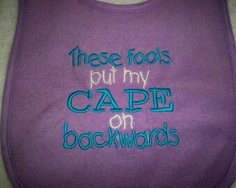 Purple Bib - These Fools Put My Cape on Backwards - Baby Girl Bib - Purple & Bright Blue