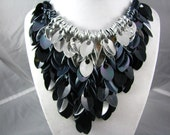 Shaggy scale necklace in silver, iridescent gunmetal, and black