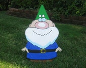 Little Gnome lawn ornament with green hat and blue coat