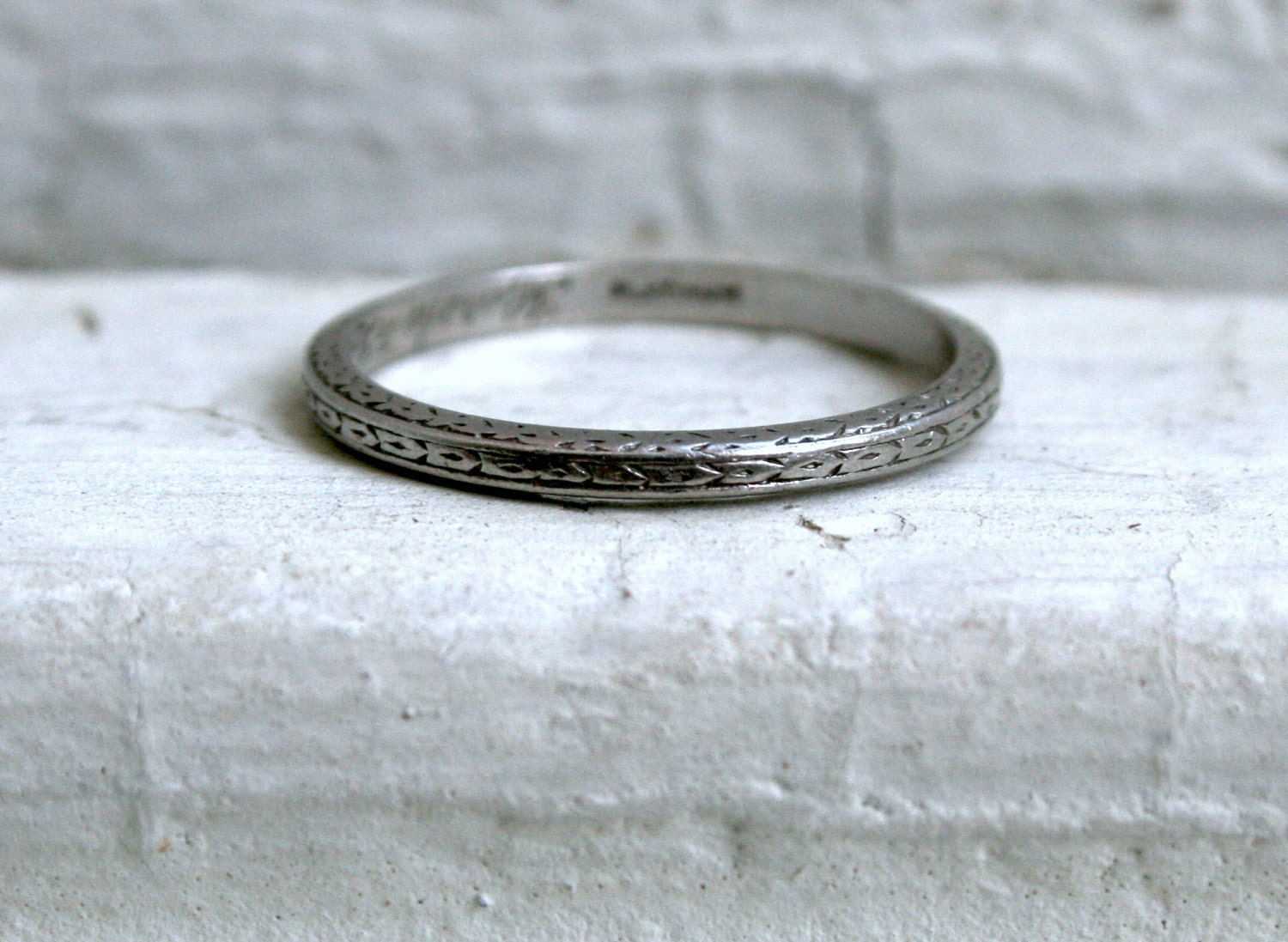sweet hand etched antique platinum wedding band.