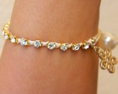 Ivory Ribbon Wrapped Antique Gold Chain Bracelet with Flower Charm and Pearl Closure