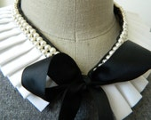 White Pleated Collar Necklace with Adjustable Bow Front and Set Pearl Embelishment