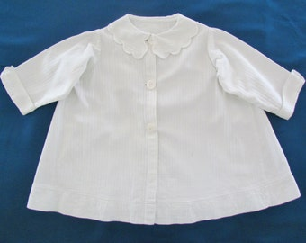 Antique child's coat, c.1910 white cotton child's coat with MOP buttons