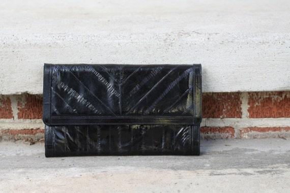vintage 1980s black eelskin clutch