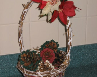 Red, White and Green Basket filled with Pinecones and topped with Artificial Poinsettias