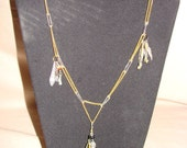 Gold and silver tone chain with metal charms