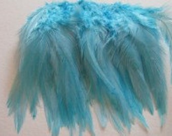 Strung Rooster Saddle Hackle - White Turquoise