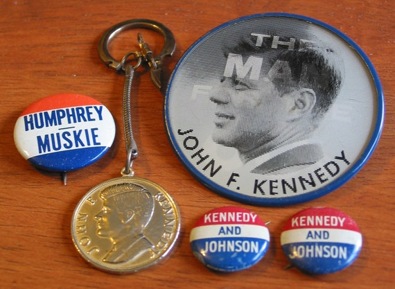 John F. Kennedy 'Man for the 60s' pin along with Kennedy key chain and other pins