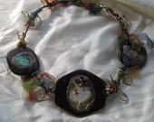 short necklace in wooden beads with pictures of Dega's dancers decorated with wired golded cooper and tull