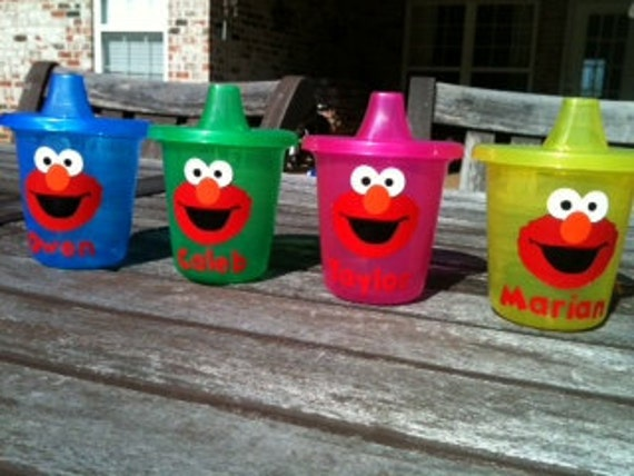5 personalized Elmo sippy cups in  pink yellow or green