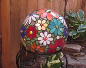 Large Gazing Garden Ball covered in beautiful colorful flowers