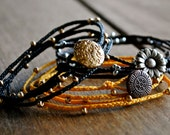 Gold and Black Irish Waxed Linen Braided Beaded Four Wrap Bracelet