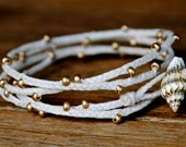 White and Gold Irish Waxed Linen Braided Beaded Four Wrap Bracelet With Shell Button
